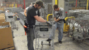 Wanzl North America factory workers construct cart
